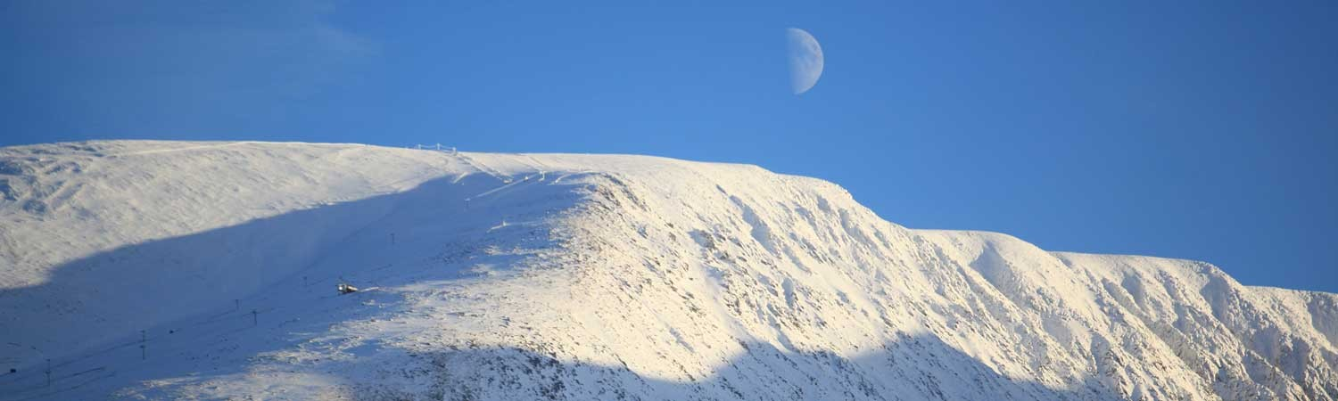 the moon often rises above Aonach Mor in the winter.