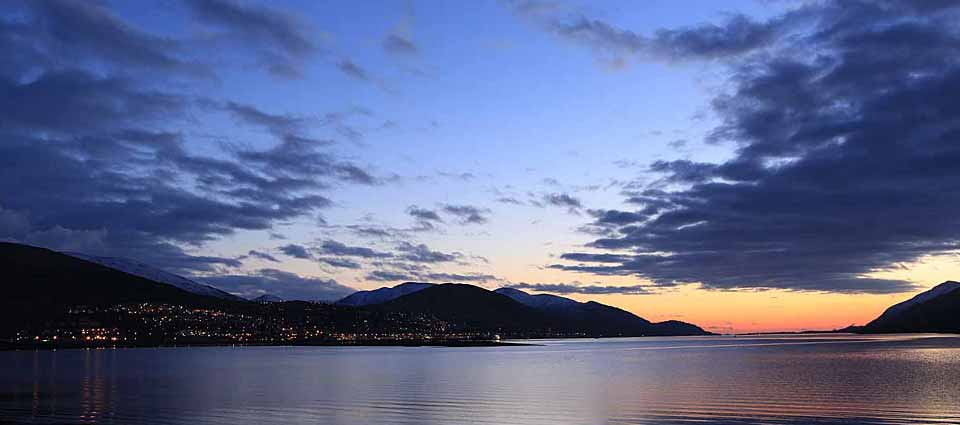 The lights of Fort William over Loch Linnhe seen from Caol Beach.